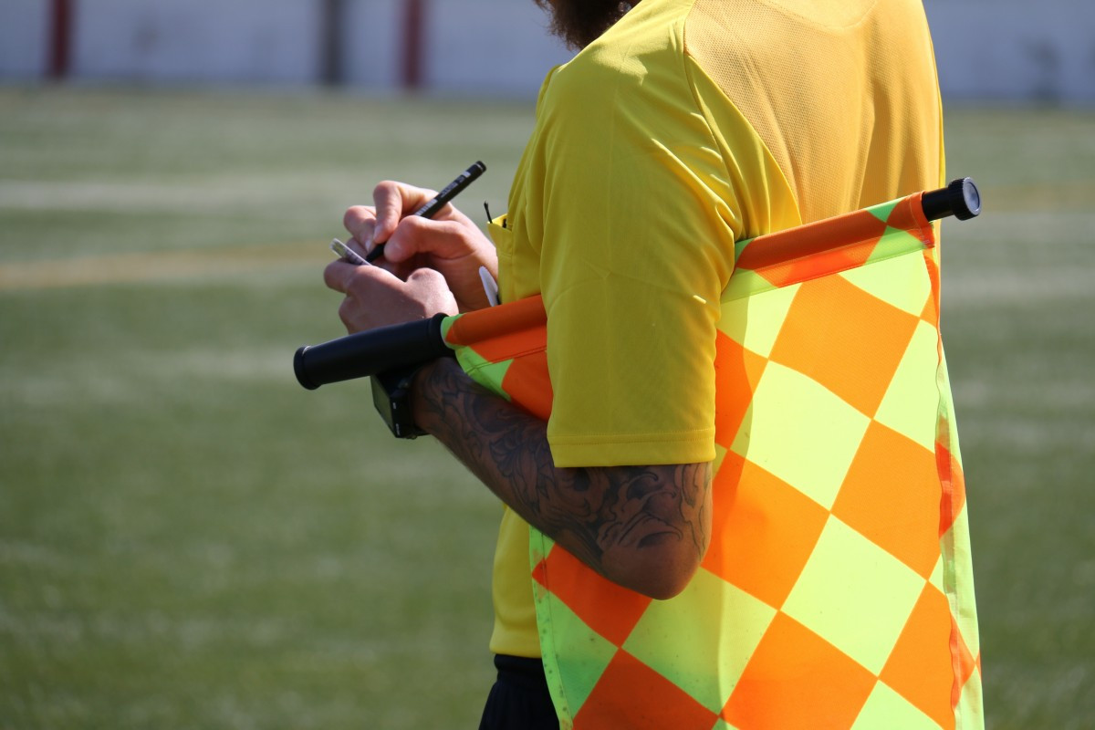 Yellow yellow card lineman referee lack football football game football field 1381826